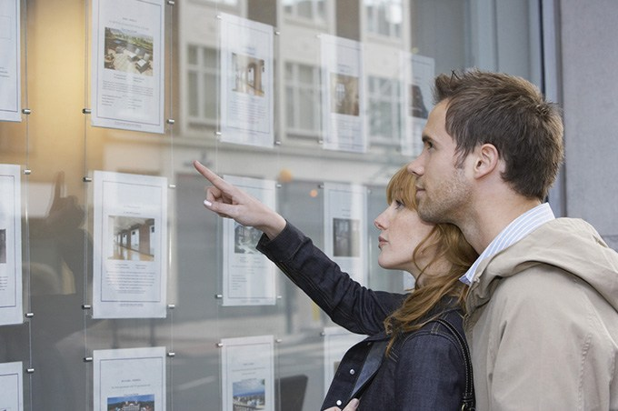 Couple looking at house listing