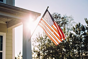 American flag outside a home | VA Home Loans