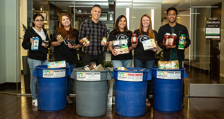 People with food drive items | Company culture