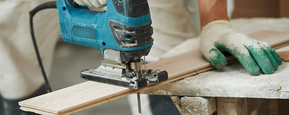 sawing wood planks