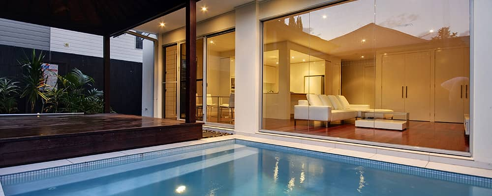 pool with view of living room