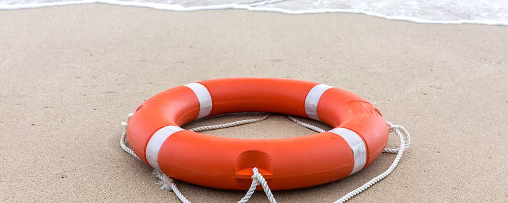 lifebuoy washed on shore