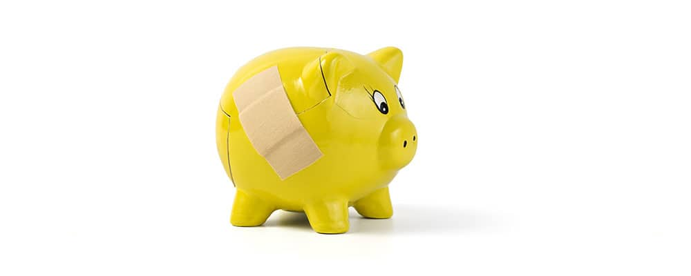 piggy bank with bandage