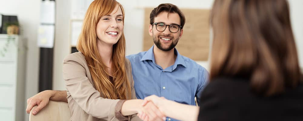 borrower shaking hand with loan officer