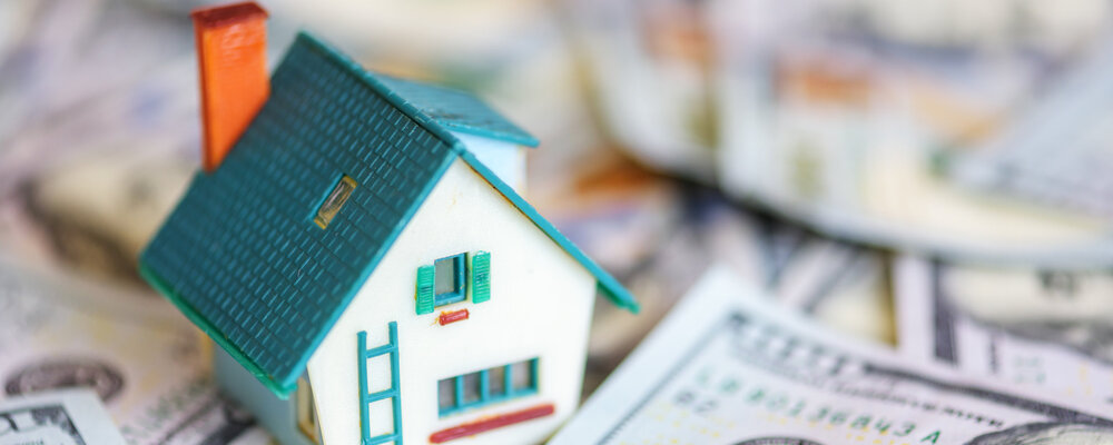 Model house on money | Homebuying Heated Up in June