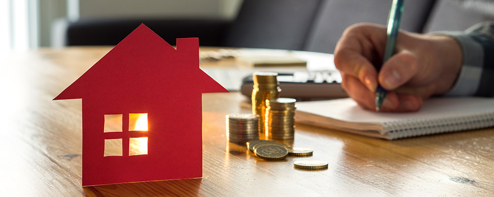 House coins notebook | Economists Expect Mortgage Rates to Remain Low