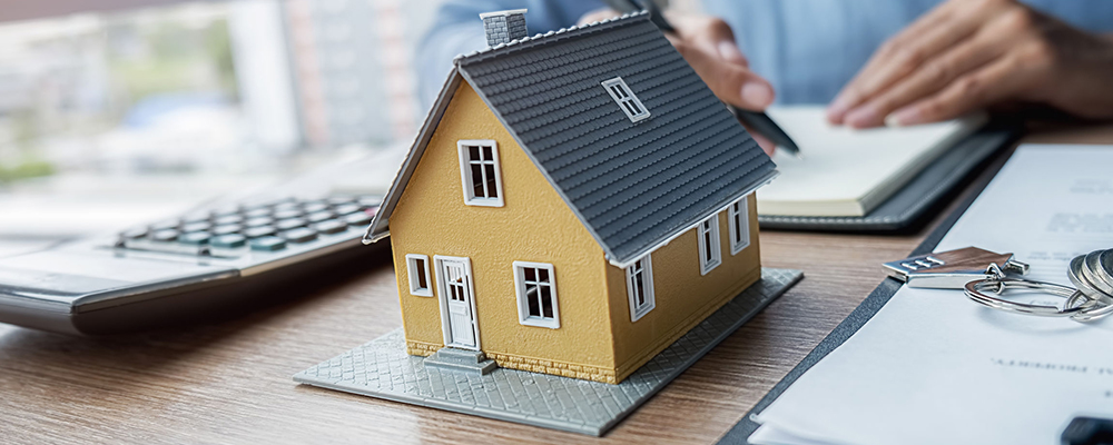 Model house on desk | Home Sales May Not Be Slowing Down After All
