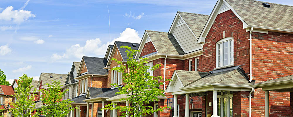 Row of houses | Homeownership Held Steady in First Quarter