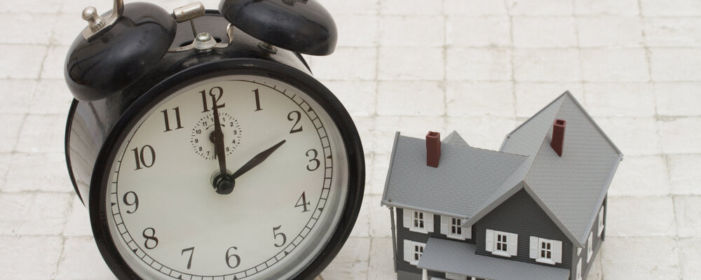 Clock and house   The Best Time to Buy a Home May Be Right Now