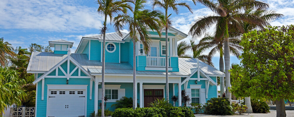 House with palm trees | Fannie Mae, Freddie Mac Remove Limits on Second Homes, Investment Properties