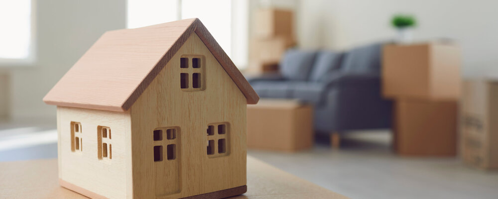 Model house and moving boxes | Homebuyers' Good Vibes Fade a Bit as Prices Rise